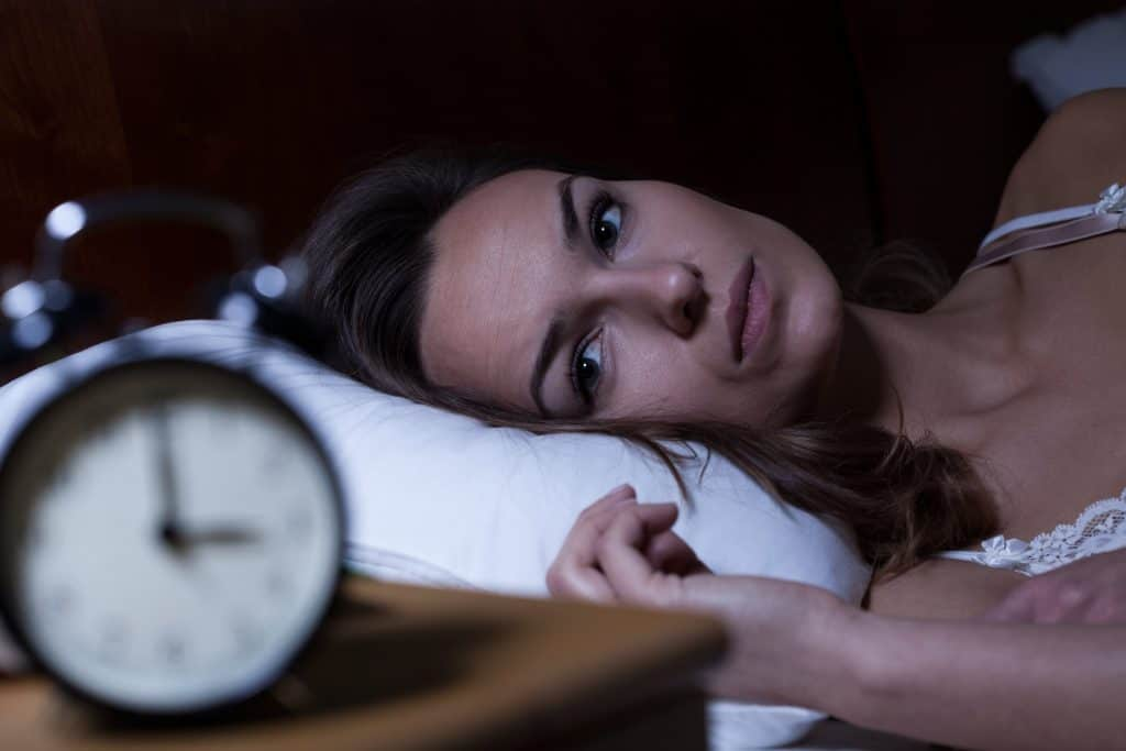 caregiver burnout - woman who cannot sleep at nighttime