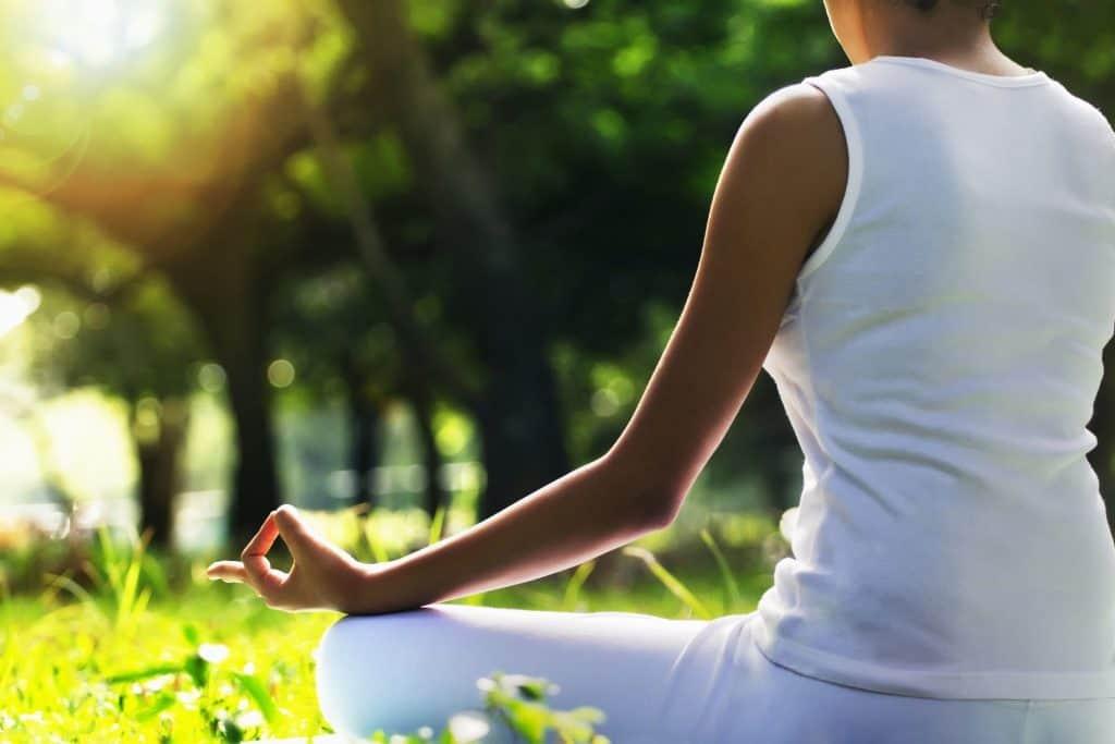 caregiver burnout - woman meditating